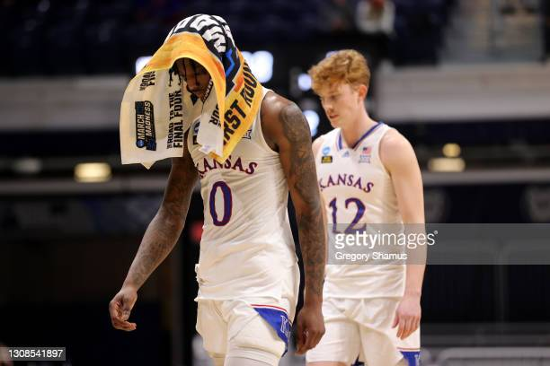 Marcus Garrett of the Kansas Jayhawks walks off the court after being defeated 85-51 by the USC Trojans in their second round game of the 2021 NCAA...