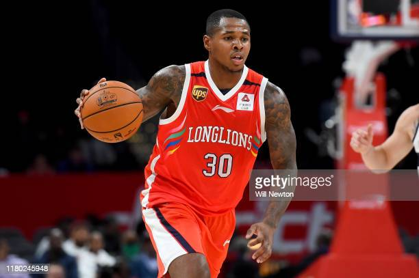 Marcus GeorgesHunt of the Guangzhou LongLions dribbles against the Washington Wizards during the first half at Capital One Arena on October 9 2019 in...
