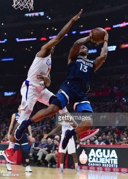 Marcus GeorgesHunt of the Minnesota Timberwolves attempts a shot over the hands of Sindarius Thornwell of the LA Clippers during the first half at...
