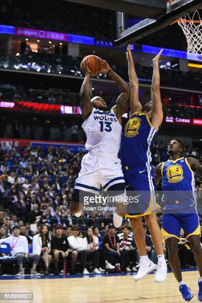 Marcus GeorgesHunt of the Minnesota Timberwolves drives to the basket against the Golden State Warriors during the game as part of 2017 NBA Global...