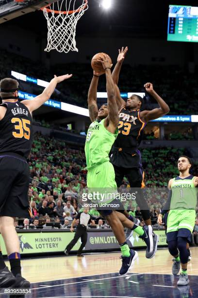 Marcus GeorgesHunt of the Minnesota Timberwolves goes up for a dunk against the Phoenix Suns on December 16 2017 at Target Center in Minneapolis...