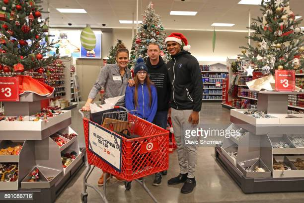 Marcus GeorgesHunt of the Minnesota Timberwolves participates in the Minnesota Timberwolves Christmas Shopping event at Target on December 8 2017 in...