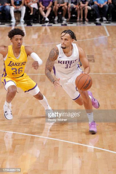 Marcus Graves of the Sacramento Kings drives to the basket against the Los Angeles Lakers during the 2021 California Classic Summer League on August...