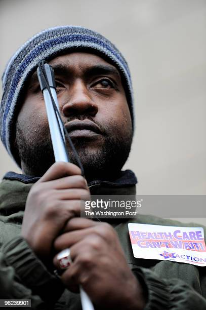 Marcus Grimes of Woodbridge, VA among other insurance abuses survivors and healthcare reform advocates protesting against the US Chamber of Commerce...