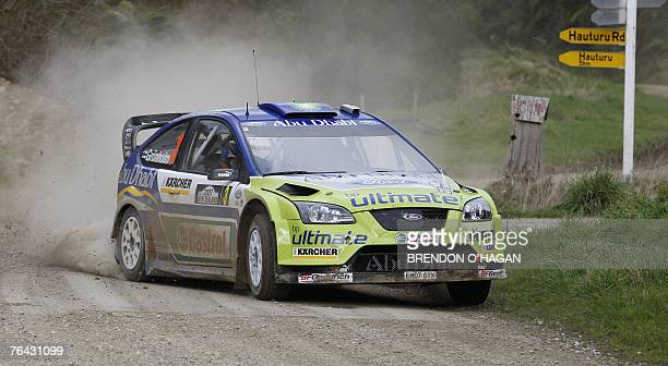 Marcus Gronholm and codriver Timo Rautiainen of Finland drive in their Ford Focus Rs during ss 4 on day one of the WRC Rally of New Zealand near...