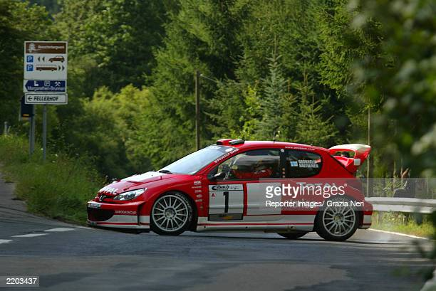 Marcus Gronholm and codriver Timo Rautiainen of Finland in the Peugeot 206 WRC during Day 1 of the World Rally Championship of Germany on July 25...