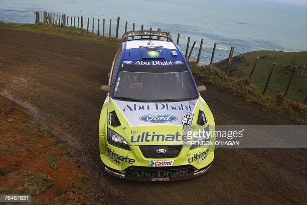 Marcus Gronholm and codriver Timo Rautiainen of Finland in their BP world team Ford Focus Rs are seen during day three of the WRC Rally of New...