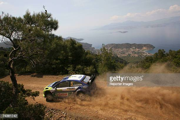 Marcus Gronholm and Timo Rautiainen of Finland compete in the Ford Focus RS during the second leg of the BP Ultimate Acropolis Rally of Greece on...