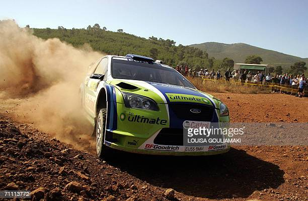 Marcus Gronholm and Timo Rautiainen of Finland drive their Ford Focus WRC through Kineta's special stage west of Athens on the third day of the Rally...
