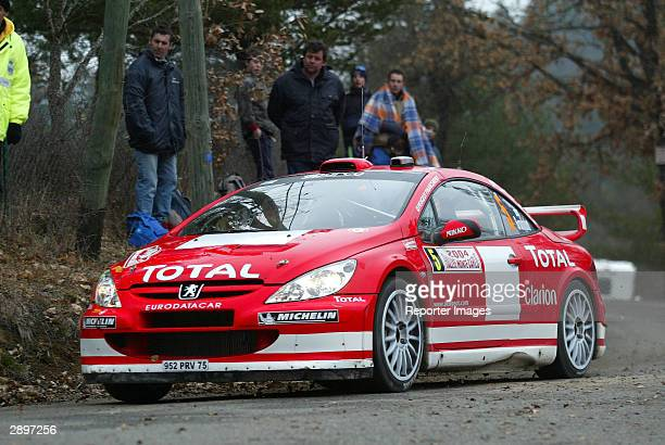Marcus Gronholm of Belgium drives his Peugeot 307 WRC in the Monte Carlo Rally January 24 2004 in Monaco