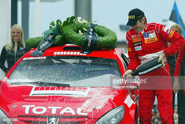 Marcus Gronholm of Finland celebrate on the podium after winning the WRC 2005 Rally of Finland on August 7 2005 in Jyvaskyla Finland