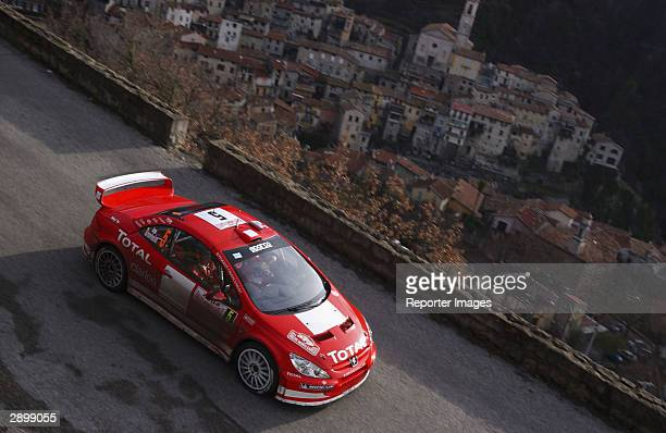 Marcus Gronholm of Finland drives his Peugeot 307 WRC in the Monte Carlo Rally January 25 2004 in Monaco