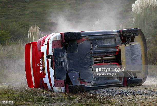 Marcus Gronholm of Sweden and Peugeot crashes during the first day of the WRC Rally of New Zealand on April 16 2004 in Paparoa New Zealand