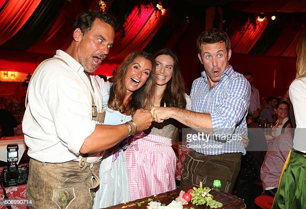 Marcus Gruesser and his girlfriend Sylvie Lindenbauer Jan Hartmann and his wife Julia Hartmann during the Birgitt Wolff's PreWiesn party ahead of the...