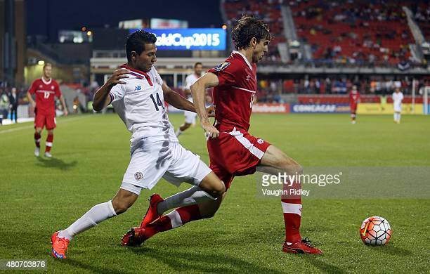 Marcus Haber of Canada and Deyver Vega of Costa Rica battle for the ball during the 2015 CONCACAF Gold Cup Group B match between Canada and Costa...