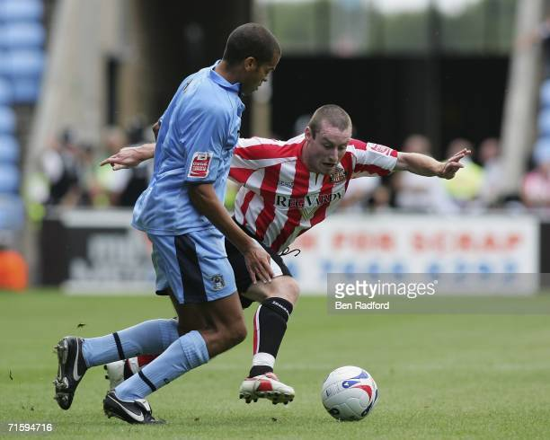 Marcus Hall of Coventry City and Stephen Elliott of Sunderland in action during the CocaCola Football League Championship game between Coventry City...