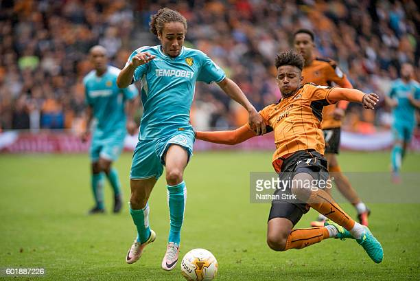 Marcus Harness of Burton Albion is challenged by Cameron BorthwickJackson of Wolverhampton Wanderers during the Sky Bet Championship match between...
