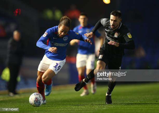 Marcus Harness of Portsmouth attempts to move with the ball past Joe Martin of Northampton Town during the Leasingcom Trophy match between Portsmouth...
