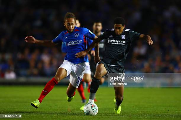 Marcus Harness of Portsmouth battles for the ball with Jude Bellingham of Birmingham City during the Carabao Cup First Round match between Portsmouth...