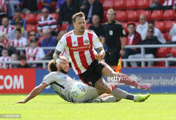 Marcus Harness of Portsmouth brings down Chris Maguire of Sunderland during the Sky Bet League One match between Sunderland and Portsmouth at Stadium...