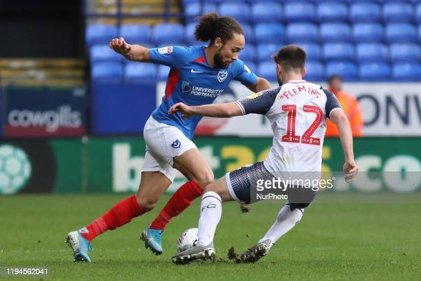Marcus Harness of Portsmouth FC battles for possession with Brandon Fleming of Bolton Wanderers during the Sky Bet League 1 match between Bolton...