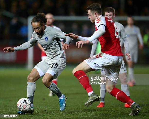 Marcus Harness of Portsmouth FC battles for possession with Harry Souttar of Fleetwood Town during the FA Cup Third Round match between Fleetwood...
