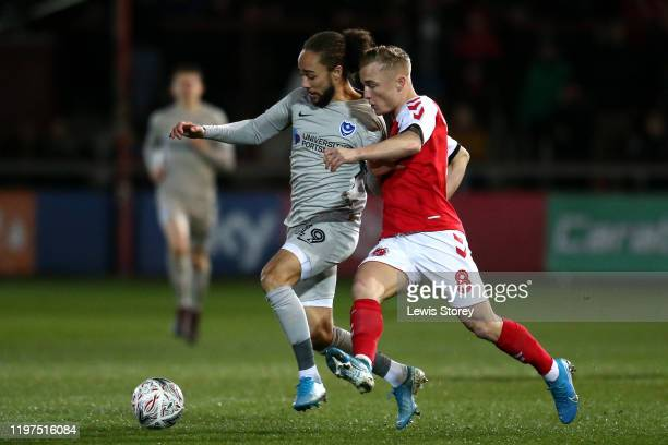 Marcus Harness of Portsmouth FC battles for possession with Kyle Dempsey of Fleetwood Town during the FA Cup Third Round match between Fleetwood Town...