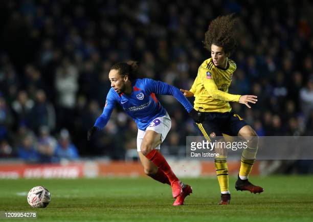 Marcus Harness of Portsmouth FC battles for possession with Matteo Guendouzi of Arsenal during the FA Cup Fifth Round match between Portsmouth FC and...
