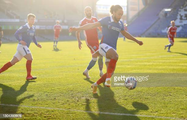 Marcus Harness of Portsmouth FC controls the ball in the corner during the Sky Bet League One match between Portsmouth and Gillingham at Fratton Park...
