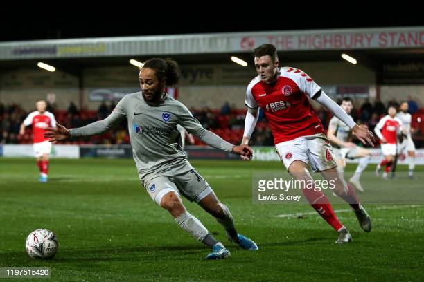 Marcus Harness of Portsmouth FC turns with the ball away from Harry Souttar of Fleetwood Town during the FA Cup Third Round match between Fleetwood...