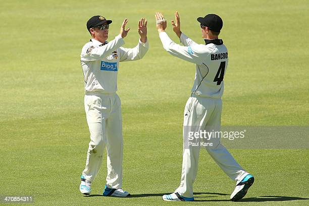 Marcus Harris and Cameron Bancroft of the Warriors celebrate the dismissal of Sean Abbott of the Blues during day two of the Sheffield Shield match...