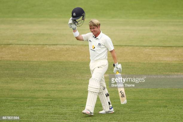 Marcus Harris of the Bushrangers celebrates scoring his century during the Sheffield Shield final between Victoria and South Australia on March 26...