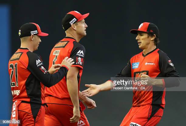 Marcus Harris of the Renegades celebrates with Bradd Hogg after taking a catch to dismiss Alex Carey of the Strikers during the Big Bash League match...