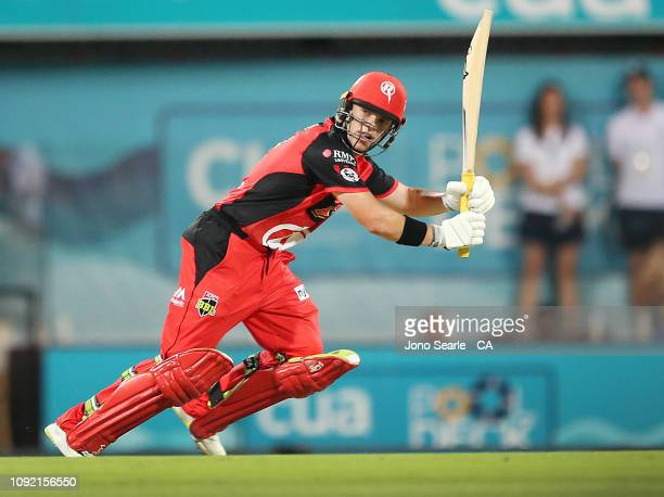 Marcus Harris of the Renegades plays a shot during the Big Bash League match between the Brisbane Heat and the Melbourne Renegades at The Gabba on...