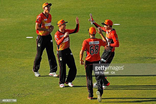 Marcus Harris of the Scorchers celebrates after taking a catch to dismiss Matthew Wade of the Renegades during the Big Bash League match between the...