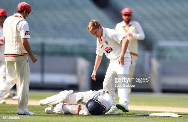 Marcus Harris of Victoria falls to the ground after colliding with and being runs with the ball out by Adam Zampa of South Australia during day two...