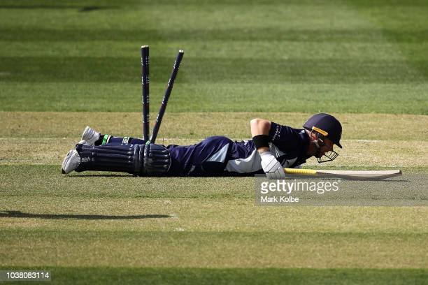 Seb Gotch of Victoria gets back to his feet after diving to make his ground during the JLT One Day Cup match between New South Wales and Victoria at...