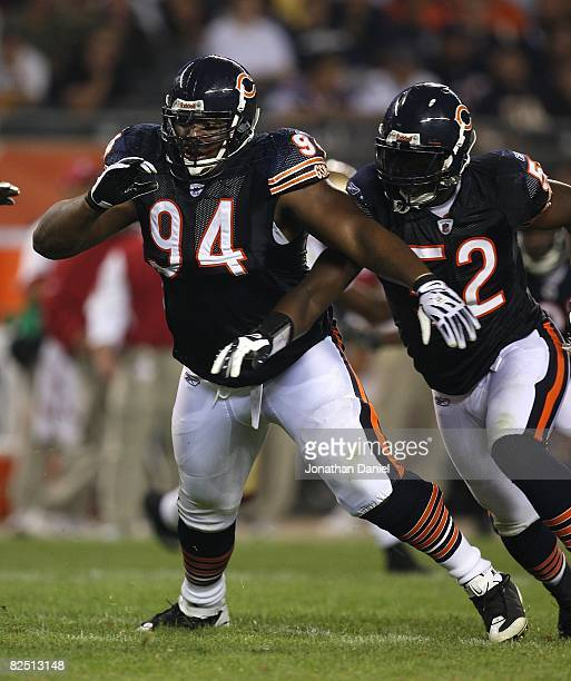 Marcus Harrison and Jamar Williams of the Chicago Bears rush the passer during a game against the San Francisco 49ers on August 21 2008 at Soldier...