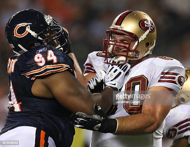 Marcus Harrison of the Chicago Bears rushes against Brian de la Puente of the San Francisco 49ers on August 21 2008 at Soldier Field in Chicago...