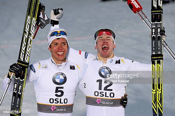 Marcus Hellner of Sweden celebrates after winning the gold medal with teammate and bronze medal winner Emil Joensson in the Men's Cross Country...