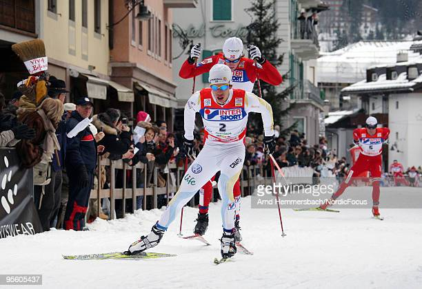 Marcus Hellner of Sweden leads Simon Oestensen of Norway and Petter Northug of Norway during the 30km men handicap start for the FIS Cross Country...