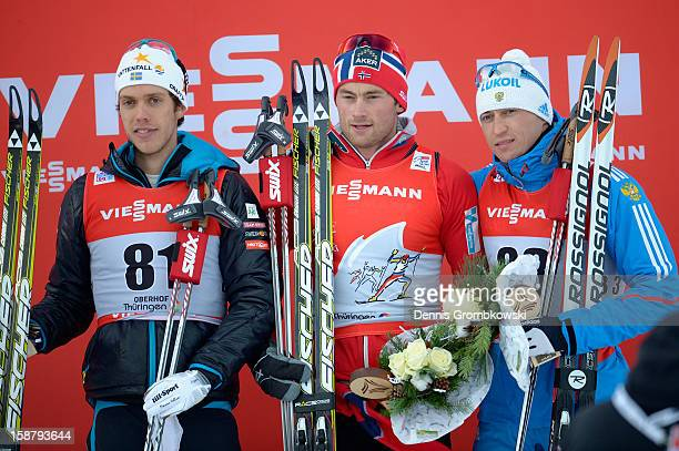 Marcus Hellner of Sweden Petter Northug of Norway and Alexander Legkov of Russia pose at the podium after in the Men's 40km Free Individual Prolouge...