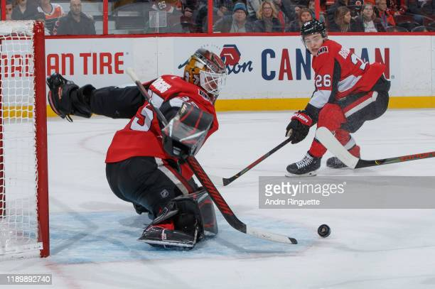 Marcus Hogberg of the Ottawa Senators makes a save in overtime against the Philadelphia Flyers as Erik Brannstrom 6looks on at Canadian Tire Centre...