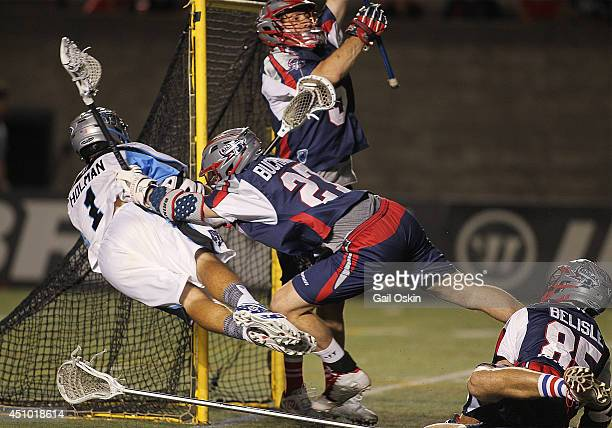 Marcus Holman of the Ohio Machine is pushed by Kevin Buchanan of the Boston Cannons in the fourth quarter during a game on June 21 2014 at Harvard...