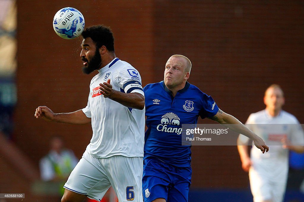 Marcus Holness (L) of Tranmere in action with Steven Naismith of Everton during the Pre Season Friendly between Tranmere Rovers and Everton at Prenton Park on July 22, 2014 in Birkenhead, England.