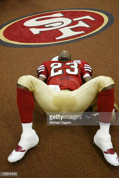 Marcus Hudson of the San Francisco 49ers stretches in the locker room before the game against the St Louis Rams at Monster Stadium on September 17...