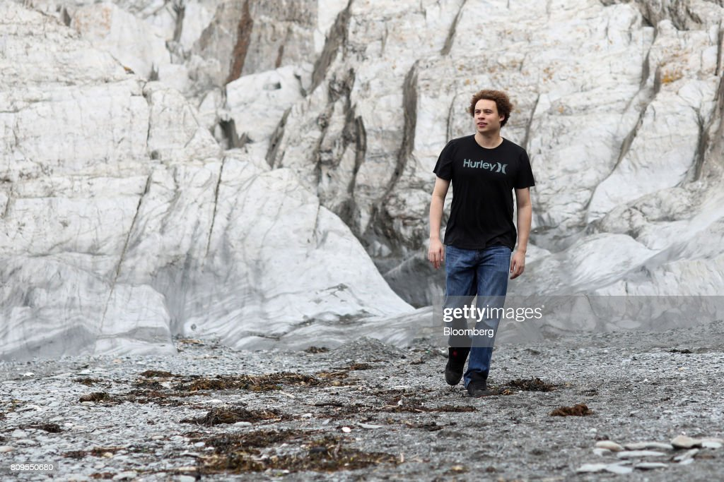 Marcus Hutchins, digital security researcher for Kryptos Logic, walks along Tunnels Beaches in Ilfracombe, U.K., on Tuesday, July 4, 2017. Hutchins, the 23-year-old who saved the world from a devastating cyberattack in May was asleep in his bed in the English seaside town of Ilfracombe last week after a night of partying when another online extortion campaign spread across the globe. Photographer: Chris Ratcliffe/Bloomberg via Getty Images