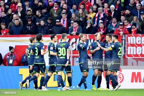 Marcus Ingvartsen of 1 FC Union Berlin celebrates with his team after scoring the opening goal during the Bundesliga match between 1 FSV Mainz 05 and...