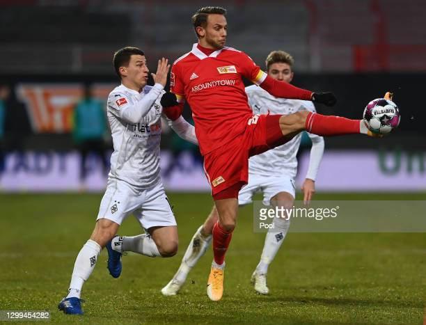 Marcus Ingvartsen of 1. FC Union Berlin is challenged by Stefan Lainer of Borussia Monchengladbach during the Bundesliga match between 1. FC Union...