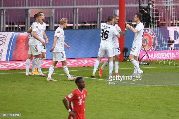 Marcus Ingvartsen of 1.FC Union Berlin celebrates with teammates after scoring their team's second goal during the Bundesliga match between FC Bayern...